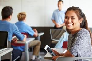 Female High School Student Digital Tablet In Classroom